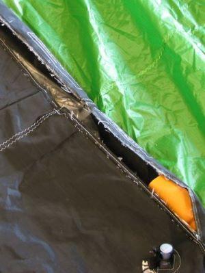 A rip in the kiteboarding kite's leading edge