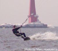 Steve riding near an icy pier
