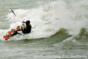 Eric kiteboarding on a wave
