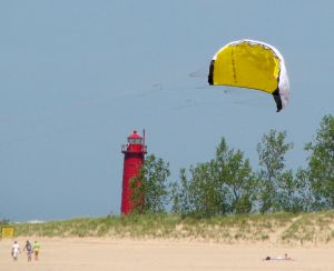Learning to kitesurf with a trainer kite