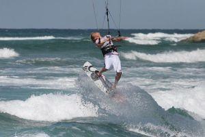 Damien LeRoy kitesurfing a tropical paradise