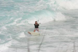 Pete Cabrinha kiteboarding the waves in the Bahamas