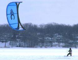 Snowkiting on a snowboard