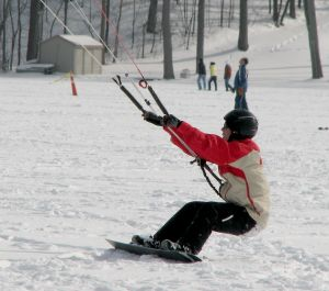 Snowkiting with a snowboard