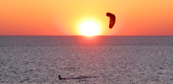 Kiteboarding at sunset in Hatteras