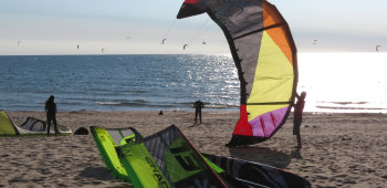 launching a kiteboarding kite at a riding spot