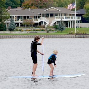Stand Up Paddleboarding with smaller kids