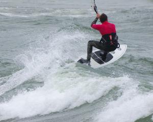 Making it past the break while kitesurfing
