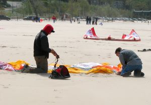 power foil kite set up- weighing down the kite with sand