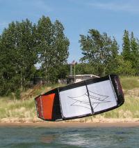 Self-landing a kiteboarding kite