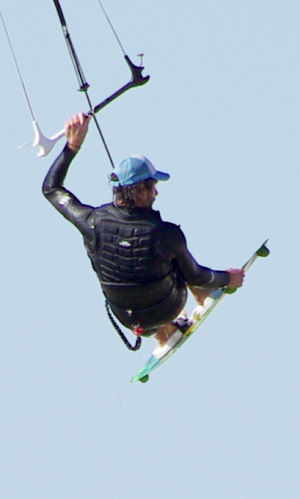Wearing a kiteboarding flotation vest and still looking cool